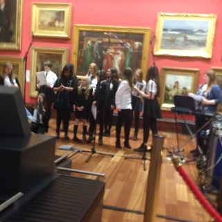 Choir performing at the McManus Gallerys as part of the Winter lLght Night